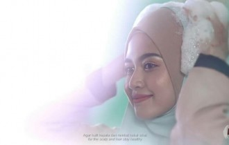 A Malaysian Shampoo advertisement showing a veiled woman taking a shower