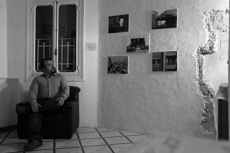 Mahmoud Ghazayel showing his photographs during a photo exhibit by ZAMAN NGO, on December 2014, in Beirut, Lebanon.